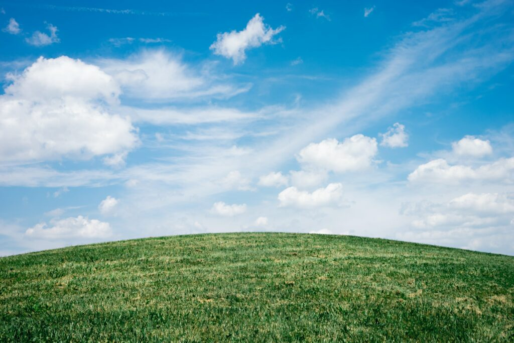 Blue sky and a green hill