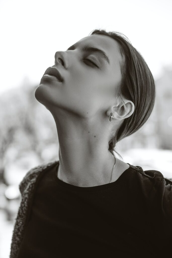 Woman looking up with neck pain